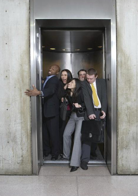 people standing in elevator. in the article below, body language expert janine driver explains how to make elevator rides less awkward. people standing i